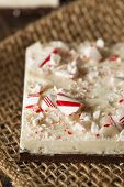 stock photo of peppermint  - Homemade Holiday Peppermint Bark with White and Dark Chocolate - JPG