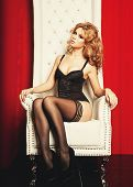 foto of throne  - sensual princess woman in black lingerie sitting on throne - JPG