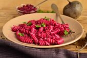 picture of beet  - Pasta with pesto beet on a wooden background - JPG
