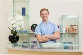 stock photo of receptionist  - Horizontal view of satisfied receptionist in spa - JPG