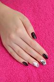 pic of nail paint  - Finger nail treatment hand with painted fingernails - JPG