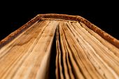 picture of hardcover book  - ancient book shot on black background - JPG