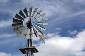picture of windmills  - Rustic Windmill with rust showing on fan blades - JPG
