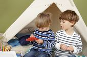 picture of teepee  - Kids engaged in arts and crafts activity playing in a teepee tent at home - JPG