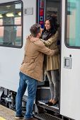 picture of long distance relationship  - pair on arrival on a platform at a station - JPG