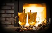 image of christmas spices  - Two glasses of tea with christmas decoration at romantic fireplace  - JPG