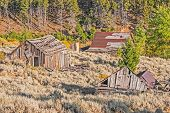 stock photo of outhouses  - Two homes an outhouse and a school were all once part of a thriving mining town in Montana - JPG