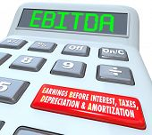 image of amortization  - EBITDA word in digital letters on a calculator display to illustrate earnings before interest - JPG