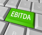 stock photo of amortization  - EBITDA word acronym on a computer keyboard key or button to calculate profit - JPG