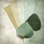 image of kirigami  - textured old paper background with kirigami butterfly - JPG