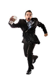 picture of running-late  - young attractive businessman with take away coffee running late to work wearing suit and tie hurry up to office in stress and overwork concept isolated on white background - JPG