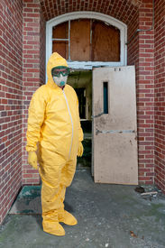 stock photo of ppe  - Man wearing a hazmat suit in the face of infectious disease - JPG