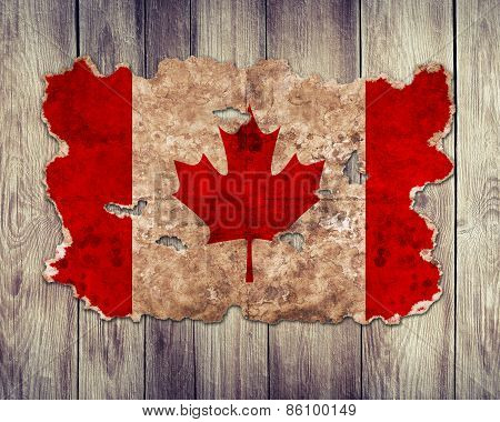Canada Flag In Form Of Torn Vintage Paper