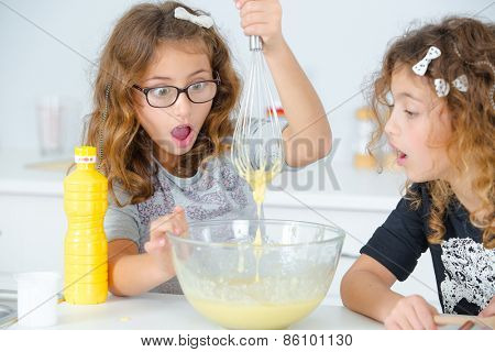Two sisters baking