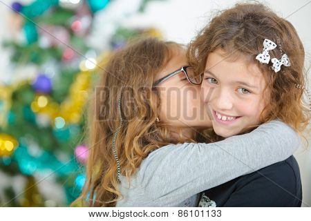 Two young sisters at Christmas