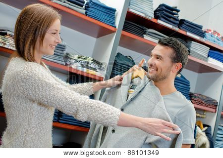 Buying clothes for her boyfriend