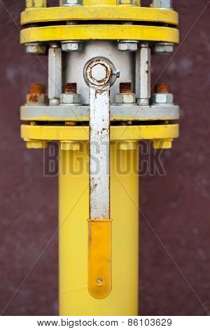 Yellow Gas Pipe With A Crane And Gear
