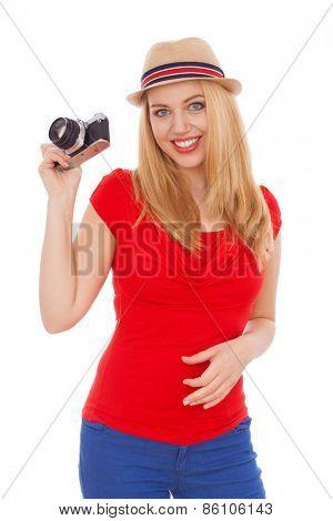 Teenage girl holding a retro film camera