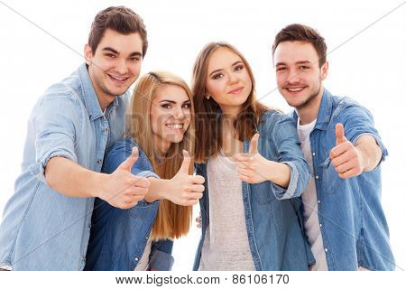 Group of happy young people showing thumbs up, isolated on white background