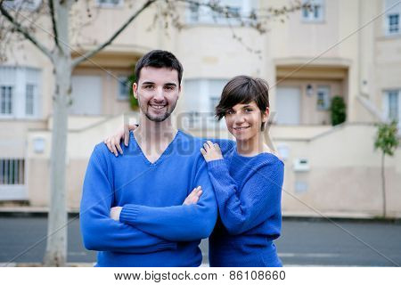 Young lovers dressed in blue excited about your new home