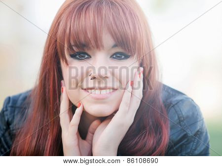 Portrait of rebellious teenager girl with red hair