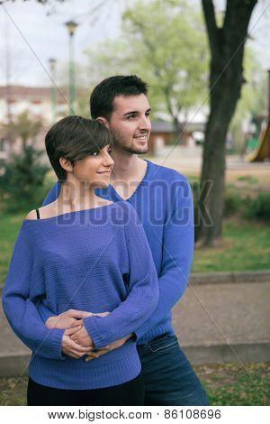 Young lovers dressed in blue looking at side