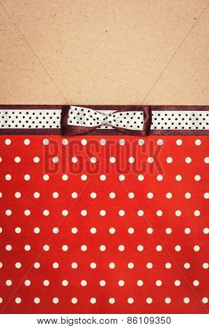 Vintage Background With Polka Dot Paper, Old Paper And Brown And White Polka Dot Ribbon With Bow