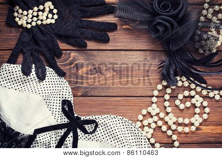 Retro Dress And Accessories On Wooden Background