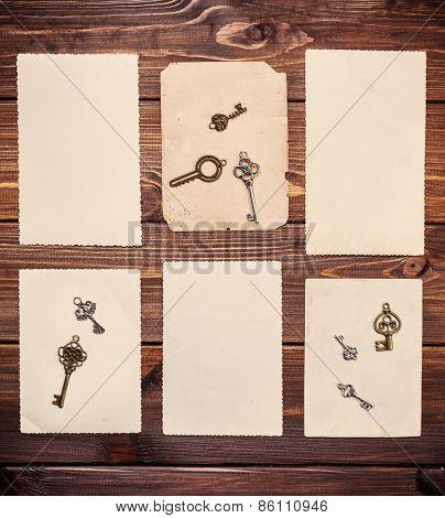 Old Paper Sheets With Vintage Keys On Wooden Background