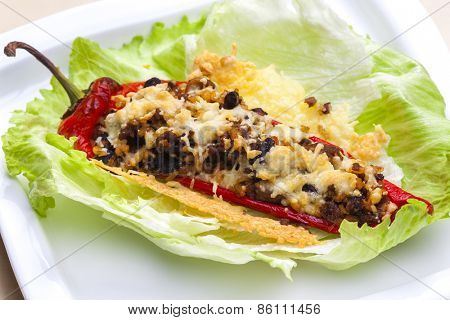 baked pepper baked filled with beans, mushrooms and minced meat