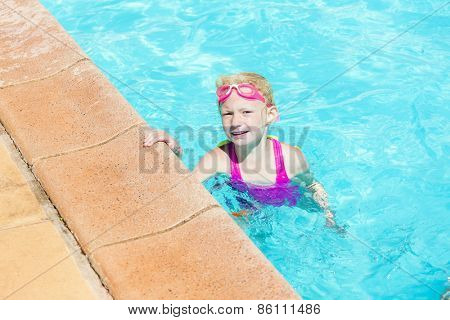 little girl swimming in the pool