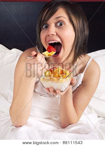 Woman In Bed Heaving Breakfast