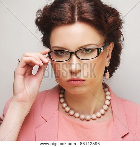 Young businesswoman in pink wearing glasses. Funny pictures.
