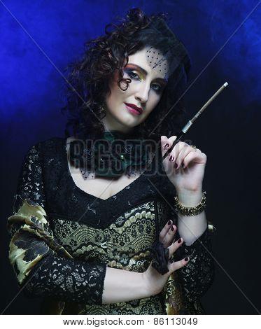 Elegabce woman smoke.Creative make up.