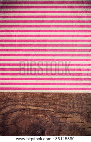 Pink Striped Paper Laying On Wooden Table