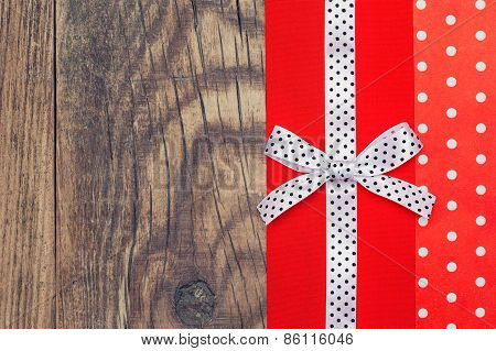 Vintage Background With Wood, Polka Dot Paper And Red And White Polka Dot Ribbon With Bow