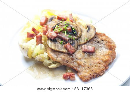 fried pork fillet with ham, mushrooms and potatoes