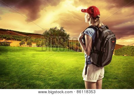 Happy Woman Hiker With Backpack Looking At Nice Green Field