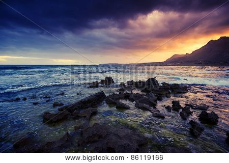 Fantastic view of the nature reserve Dello Zingaro. Dramatic morning scene. Dark overcast sky. Location cape San Vito. Sicilia, Italy, Europe. Mediterranean and Tyrrhenian sea. Beauty world.