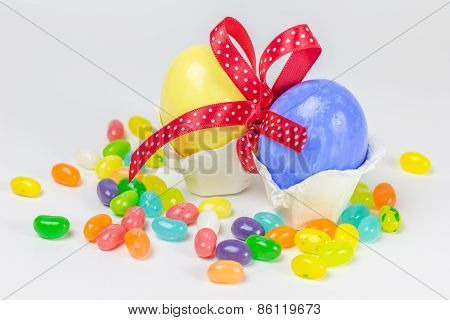 Easter Eggs In Little Nest Decorated With Red Ribbon And Jelly Belly