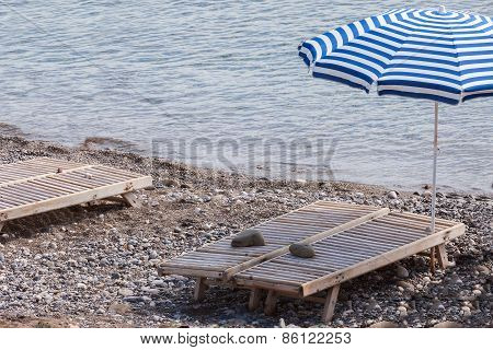 plank bed on a pebble beach