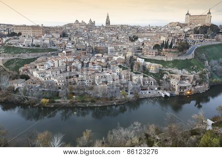 Toledo Panoramic View At Sunset With Tajo River In Spain