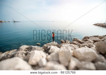 Woman on the rocky beach