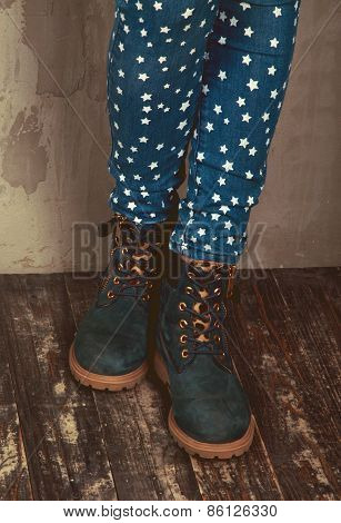Female Legs. Wearing Jeans With Stars And Suede Boots