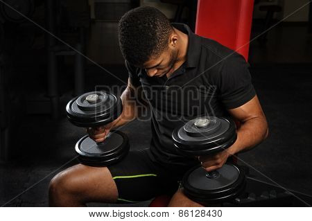 young man sitting on bench at gym