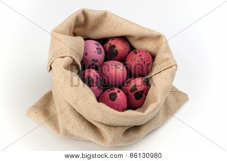 Pink Quail Easter Eggs  In Bag On White Background