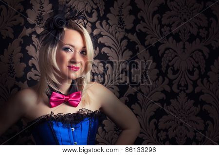 Beautiful Cabaret Woman Wearing Fascinator, Bow-tie And Corset Against Retro Wallpapers