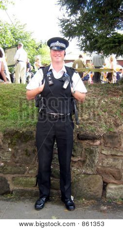 policeman/British police at work standing smiling