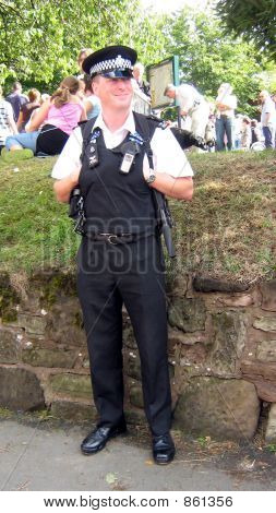 British policeman/sergeant in uniform standing smiling