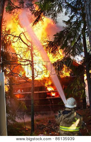 Fireman Use Water On House In Fire